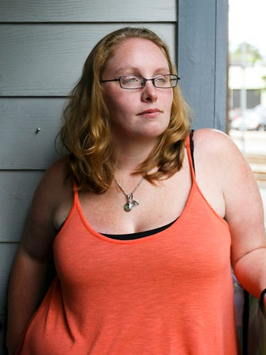 Mia Storm, 32, stands on her balcony as she recounts