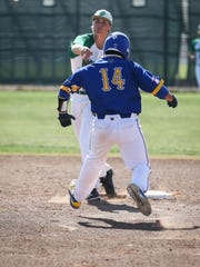 Wall's Jake Jansa throws the ball back to first after