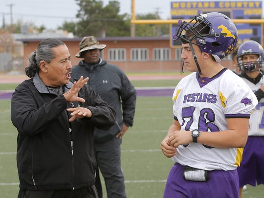 Burges HIgh School defensive end Jerry Molina receives