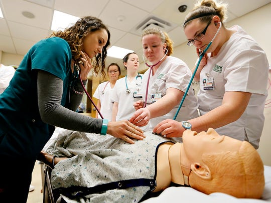 From left, respiratory therapy student Courtney Palla,