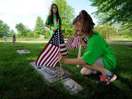 Elementary students Sofia Messina, 12 left, and Molly