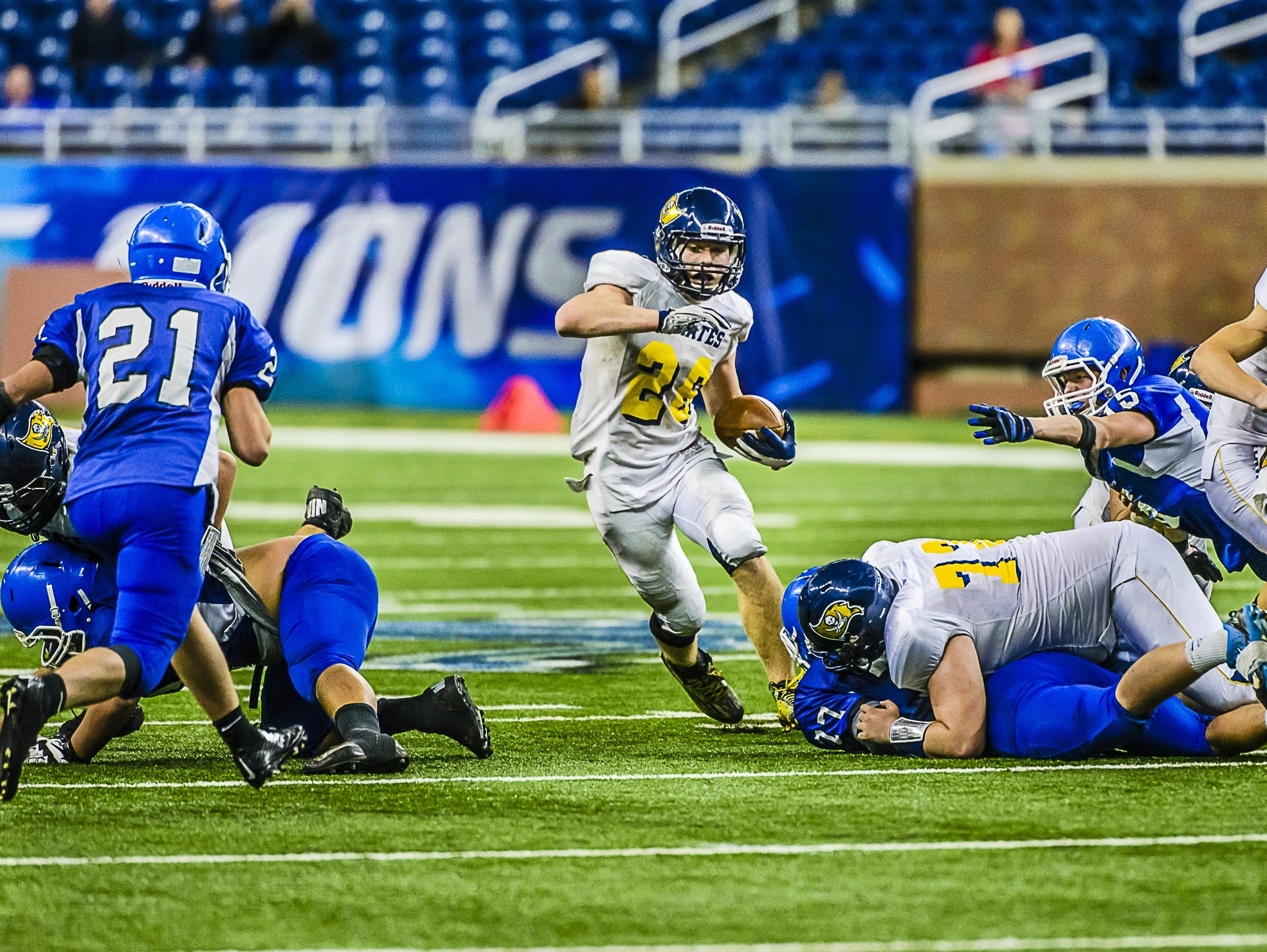 Jared Smith, of Pewamo-Westphalia, cuts back to a hole in the Ishpeming line late in the state high school football title game last season. He ended the season with 3,250 rushing yards, a new state record. Smith is one of nine returning players on offense and defense for the Pirates.