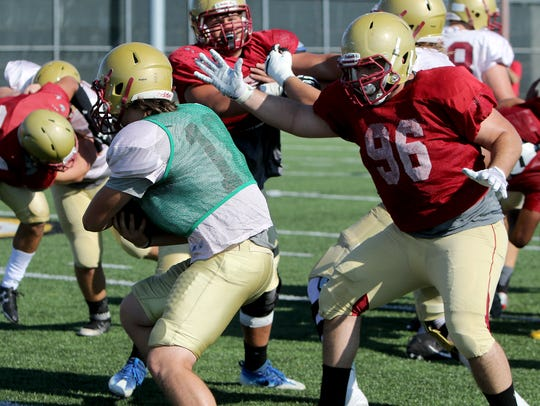 A Midwestern State defensive lineman closes in on quarterback