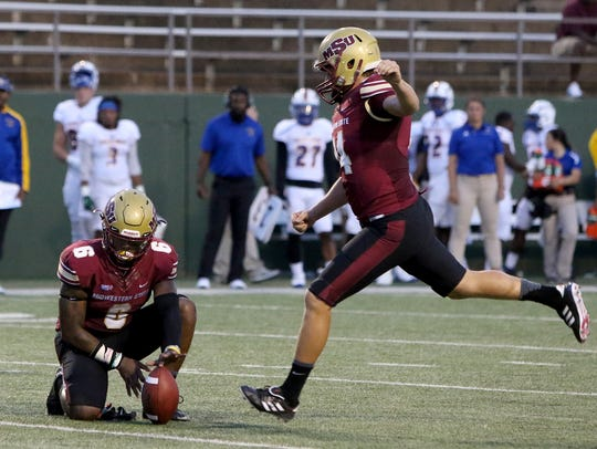 Midwestern State's Mitchell Henton kicks the extra