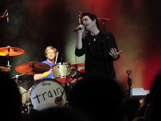 Train performs on the 18th green for energized fans