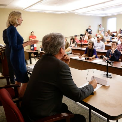 Two candidates for the Louisiana Supreme Court, State District Judge Marilyn Castle  and Appellate Court Judge Jimmy Genovese, debate at University of Louisiana at Lafayette Sept. 26, 2016.