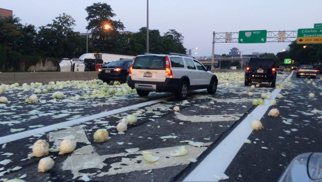 A truck carrying cabbage rolled over dumping its load across Interstate 490 east near the Clinton Avenue exit in Rochester,NY on Aug. 31, 2015.   The truck was heading west when it rolled.