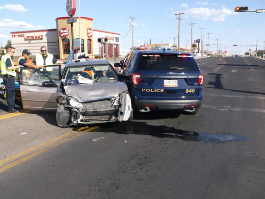 The driver and passenger in a Honda sedan, both elderly