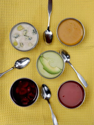Summer soups, clockwise from top left: Chilled Stilton and Pear Soup, Cold Carrot-Coconut Soup, Lightly Spiced Tomato Soup, Cherry Soup, and center, Curried Avocado Soup, are a great way to use summer produce.