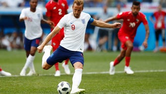 England's Harry Kane kicks a penalty to score his team's fifth goal during the group G match against Panama at the World Cup.