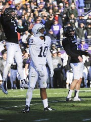 Northwestern wide receiver Christian Salem (2) and Penn State cornerback Trevor Williams (10) react after Northwestern place kicker Jack Mitchell (7) kicked the game-winning field goal in the closing second of the second half of an NCAA college football game in Evanston, Ill.,  Saturday, Nov. 7, 2015.  Northwestern beat Penn State 23-21.
