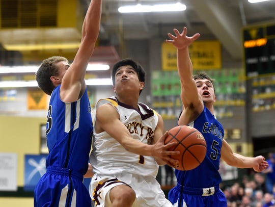Rocky Boy's Kordell Small shoots attempts a layup as