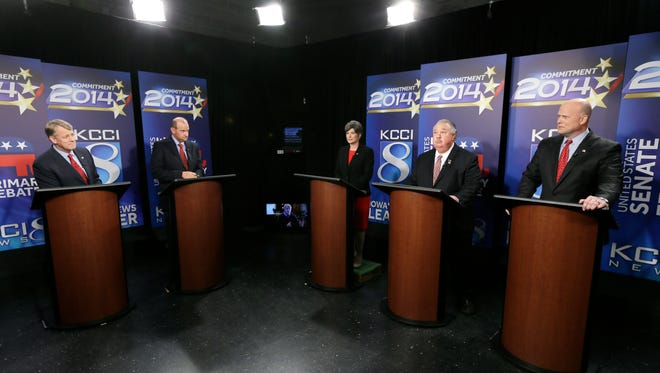 Iowa Republican senatorial candidates, from left, retired CEO Mark Jacobs; Ames, Iowa businessman Scott Schaben; State Sen. Joni Ernst; college professor Sam Clovis and former U.S. Attorney Matt Whitaker stand on stage before a live televised debate at KCCI-TV studios, Thursday, May 29, 2014, in Des Moines.