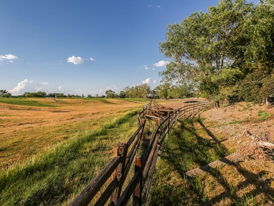 Pasture land is part of the 15-acre Flanigan estate at 2750 Holcomb Ranch Lane south of Windy Hill.