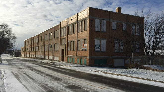 This warehouse at 506 Hosmer St., formerly used by the Michigan Liquor Control Commission, will be redeveloped into a self-storage facility next year.