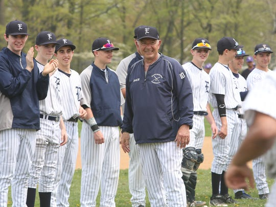 Eastchester baseball coach Dom Cecere greets his current team during a ceremony at Eastchester High School May 10, 2014. Cecere was honored for 50 years of coaching baseball at Eastchester.