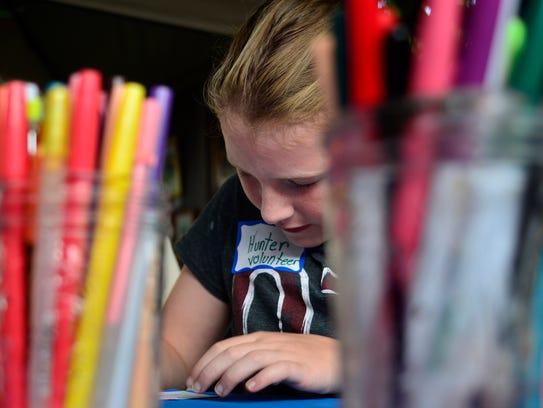 Hunter Commins, 9, of Spring Garden Township creates