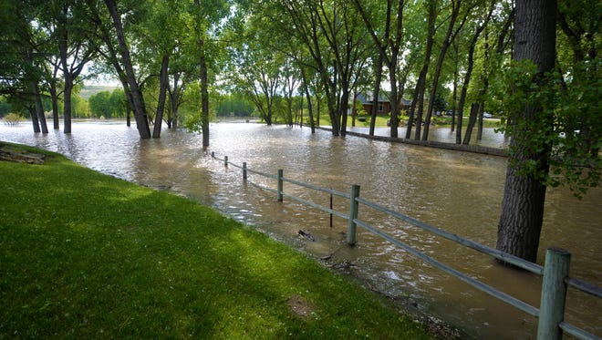 A portion of Cal Ekland's property and an adjacent private driveway are covered in several feet of floodwater from the Missouri River on Thursday.  On Wednesday the USGS predicted that the river would crest at 17 feet Thursday, but service later amended their prediction to 14 feet.