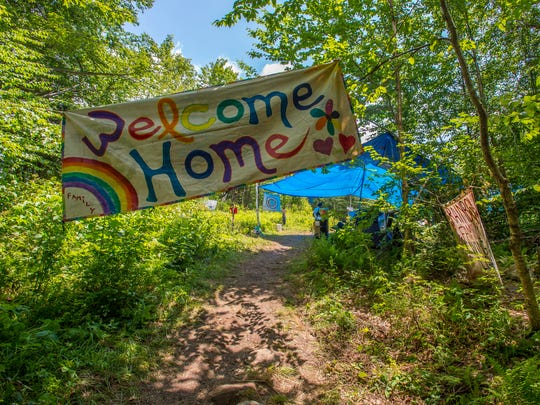 A Welcome Home sign greets attendees at the Rainbow Family National Gathering in the Green Mountain National Forest in Mt. Tabor on Tuesday, June 28, 2016.