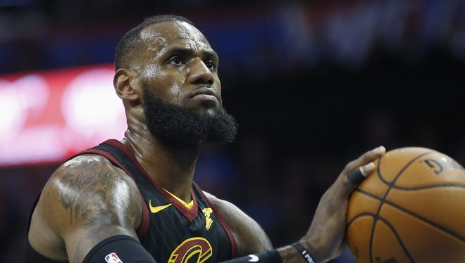 Cleveland Cavaliers forward LeBron James shoots a foul shot during an NBA basketball game against the Oklahoma City Thunder in Oklahoma City, Tuesday, Feb. 13, 2018. (AP Photo/Sue Ogrocki) ORG XMIT: OKSO