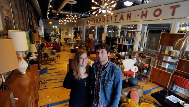 Danielle and Drew Levinson of Toms River, owners of Flux Modern, a mid-century modern and vintage shop, showcase some items for sale at the shop in Asbury Park, NJ Tuesday, May 3, 2016.