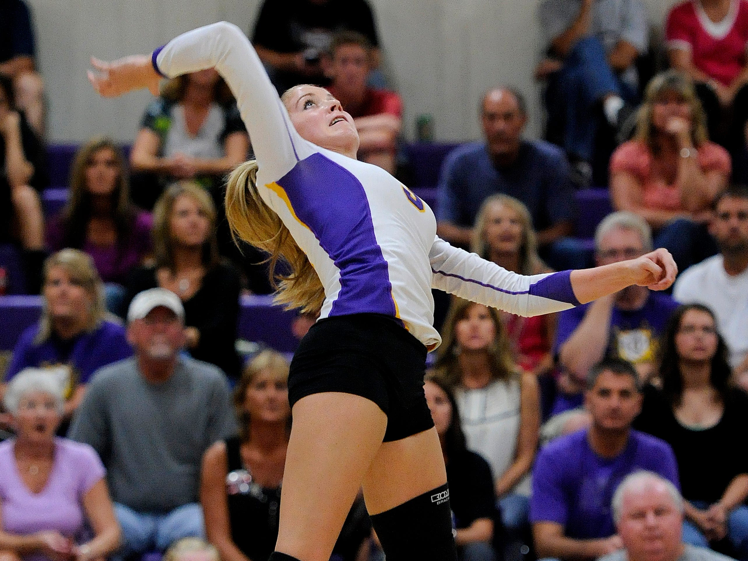 Unioto's Alexis Overly jumps into the air to spike the ball during Thursday's nonleague match against Logan Elm.