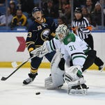 Buffalo Sabres center Sam Reinhart (23) reacts as Dallas Stars goaltender Antti Niemi (31), of Finland, makes a save during the first period of an NHL hockey game, Tuesday Nov. 17, 2015 in Buffalo, N.Y. Reinhart had a goal waived off by new NHL replay rule regarding offside.