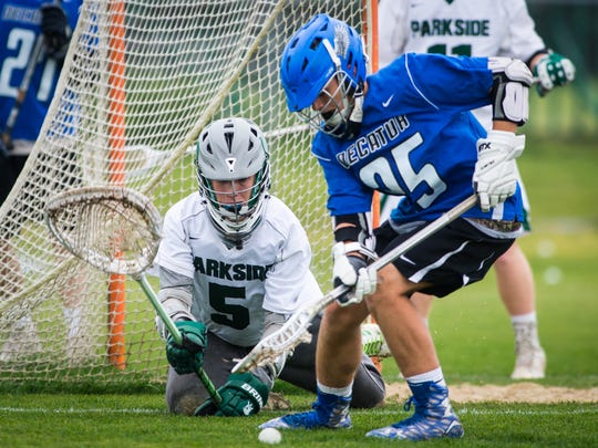 Parkside goalkeeper Phil Gianelle (5) dives after a loose ball against Stephen Decatur attack Charlie Coates (25) in the first round of the MPSSAA 2A/3A lacrosse playoffs on Wednesday, May 11 at Parkside High School in Salisbury.