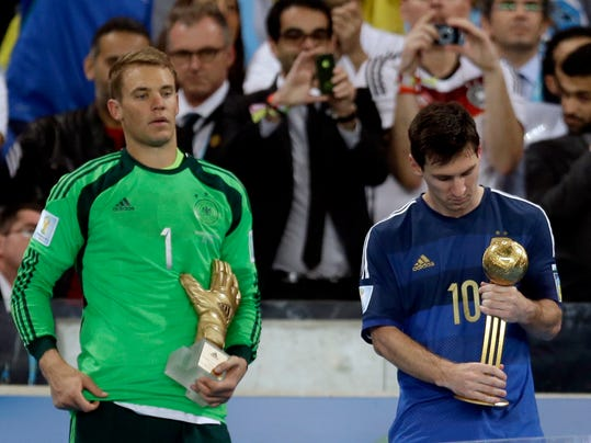Germany's goalkeeper Manuel Neuer, recipient of the Golden Glove trophy, stands next to Argentina's Lionel Messi after he receive the Golden Ball trophy following Germany's 1-0 victory over Argentina after the World Cup final soccer match between Germany and Argentina at the Maracana Stadium in Rio de Janeiro, Brazil, Sunday, July 13, 2014. (AP Photo/Natacha Pisarenko)
