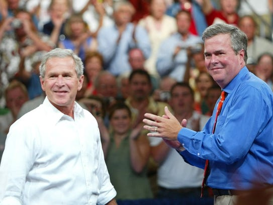 George W. Bush, left, and Jeb Bush.