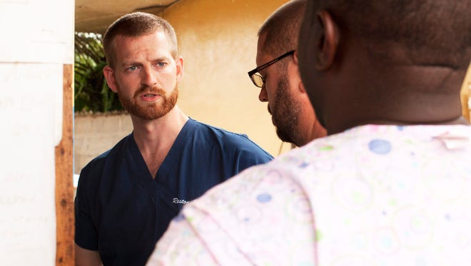 Kent Brantly works at an Ebola treatment clinic in Foya, Liberia, on June 23.