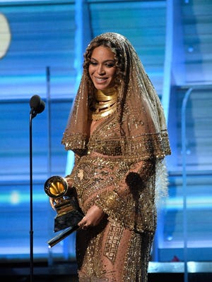 Feb 12, 2017; Los Angeles, CA, USA; Beyonce accepts Best Urban Contemporary Album during the 59th Annual Grammy Awards at Staples Center. Mandatory Credit: Robert Hanashiro-USA TODAY NETWORK
