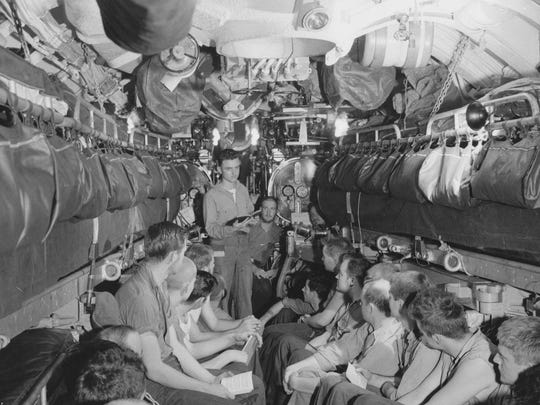 Sailors on the submarine USS Bullhead attend church service in the aft torpedo room in spring 1945. The Bullhead was the last U.S. ship sunk during World War II, killing the entire crew.