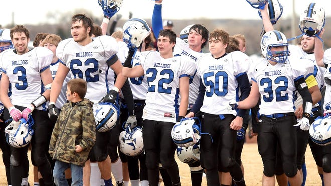 The Townsend Bulldogs celebrate their championship win after their 14-7 win over the Huntley Project Red Devils at the MHSA Class B Football Tournament game Saturday at Huntley Project High School.
