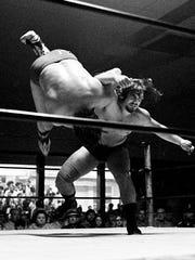 Steve Kyle, right, sends cowboy wrestler Frankie Lane