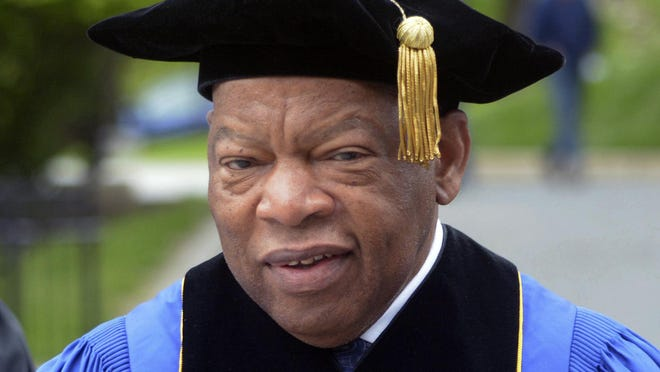 FILE - In this May 13, 2017 file photo, U.S. Rep. John Lewis, D-Ga., walks into commencement exercises at the Massachusetts College of Liberal Arts in North Adams, Mass. Lewis gave Boston University's commencement address on Sunday, May 20, 2018.