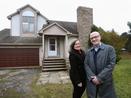 """Catherine Bianchi and David W. Barnes, of Nothnagle Realtors, worked with new owners to buy this  """"Zombie"""" house in Irondequoit."""