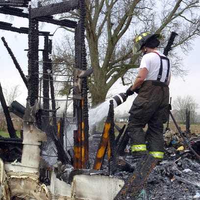Firefighters from Fire District 3 at the scene of a fatal house fire that occurred around 4 a.m. Tuesday.