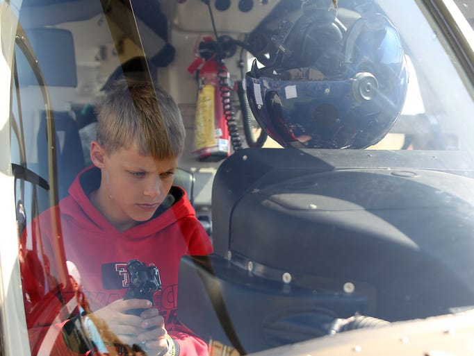 A boy looks down at a monitor inside the Shannon Medical
