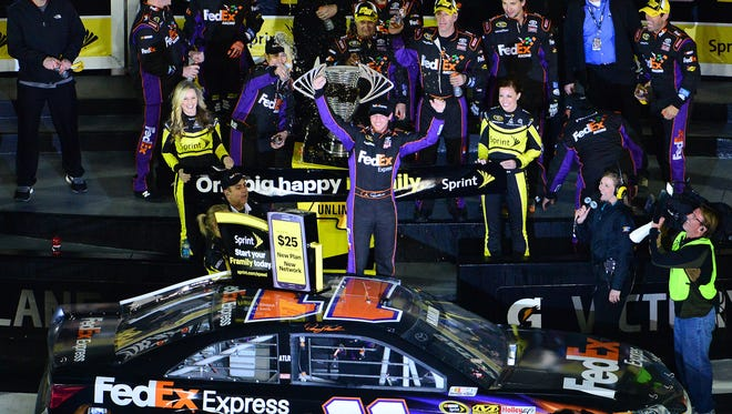 Denny Hamlin celebrates in victory lane after winning the Sprint Unlimited Saturday night at Daytona International Speedway.