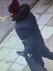 In this photo dated Saturday Feb. 14, 2015, issued by Copenhagen Police believed to show the suspected gunman in a shooting at a freedom of speech event in Copenhagen, in a photo believed to be taken on a street camera near to where the getaway car was later found dumped. In what is seen as a likely terror attack against a free speech event organized by an artist who had caricatured the Prophet Muhammad, the police believe there was only one shooter in the attack on a Copenhagen cafe that left one person dead and three police officers wounded.