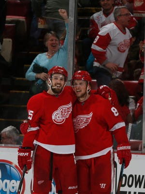 Red Wings forward Riley Sheahan hugs Justin Abdelkader after Abdelkader scored an empty net goal in the third period of the Wings' 5-2 win Monday.