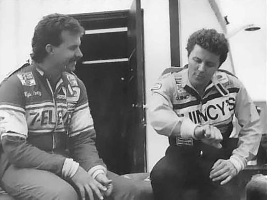 Drivers Kyle Petty and Alan Kulwicki have a discussion at the track in 1986.
