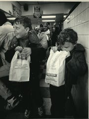 Sean Harper, 6, and his brother, Brett, 4, leave the restaurant with their historic hamburgers safely bagged at the George Webb restaurant at 4492 N. Oakland Ave. in Shorewood in 1987.