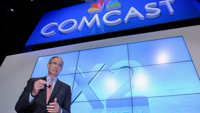 This June 11, 2013 file photo shows Comcast Corp. CEO Brian Roberts during The Cable Show 2013 convention in Washington. Comcast, the nation's biggest cable colossus, plans to swallow runner-up titan Time Warner Cable. This $45 billion deal would give Comcast 30 million subscribers in 43 of the nation's top 50 markets and about 30 percent of pay TV customers.