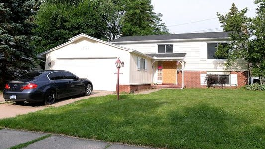 This house on Autumn Lane in Lansing Township was deemed unsafe for occupancy after investigators removed 124 living and dead cats on June 10. A remediation crew is now working inside.