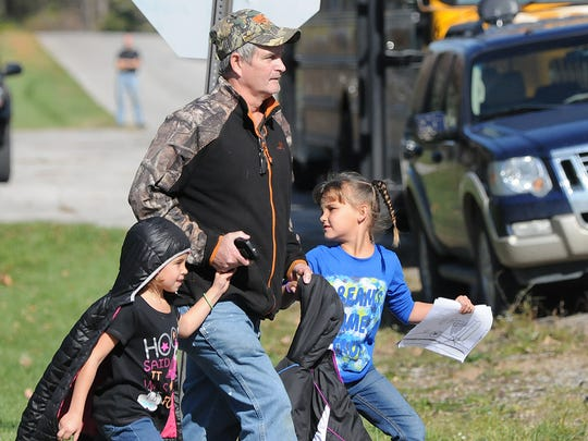 Parents picked up their children at Springmill School on Tuesday after Sherman Elemetary was evacuated due to a bomb threat. Jason J. Molyet/News Journal