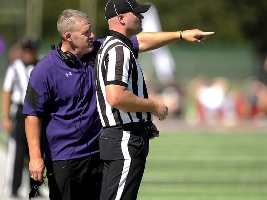 Thomas Metthe/Reporter-News Hardin-Simmons head coach Jesse Burleson discusses a call with an official during the third quarter of the Cowboys' 53-29 win on Saturday, Oct. 1, 2016, at HSU's Shelton Stadium.