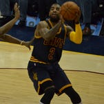 Kyrie Irving and the Cleveland Cavaliers earned a hard-fought victory over the Chicago Bulls at Quicken Loans Arena Sunday.