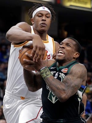 Milwaukee Bucks' Eric Bledsoe, right, goes to the basket against Indiana Pacers' Myles Turner during the first half of an NBA basketball game, Monday, Jan. 8, 2018, in Indianapolis.
